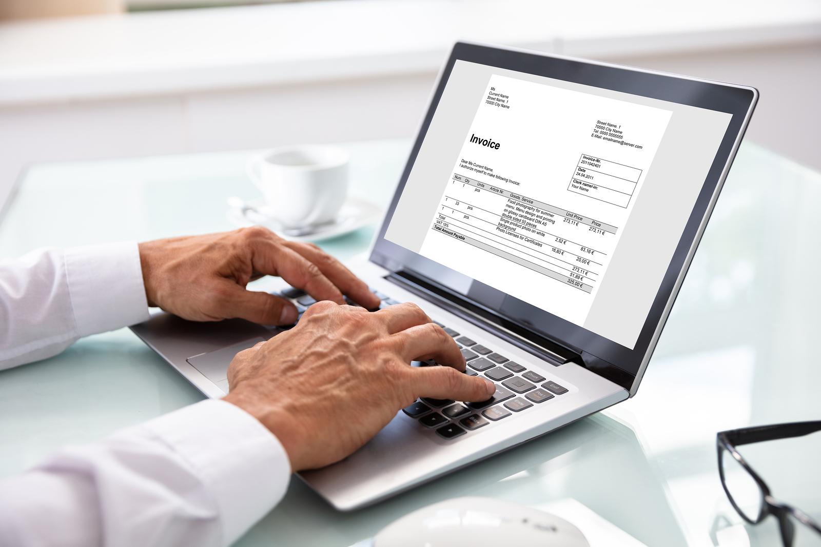 bigstock-Businessman-Checking-Invoice-O-257000698
